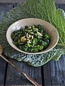 Warm Savoy cabbage-zucchini-broccoli salad with balsamic vinegar