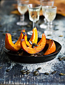 Fried pumpkin wedges with pumpkin seeds