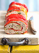 Minced meat roulade with zucchini and peppers