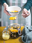 Black rice salad in a glass jar with mango cubes