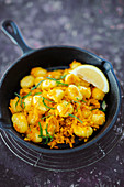 Gnocchi with pumpkin in a cast iron pan