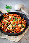 Turkey pan with beans and tomatoes in a cast iron pan