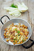 Warm fennel quinoa salad with chickpeas in a pan