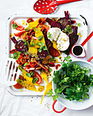 Salad with beetroot and golden beets, tomatoes, mozzarella and herbs