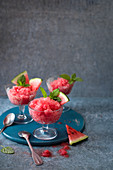 Watermelon granita with fresh watermelon and mint in stem glasses