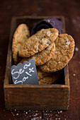 Chocolate chip cookies with sea salt in a wooden box
