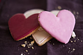 Three heart-shaped biscuits with icing