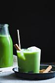 Green matcha drink with cinnamon