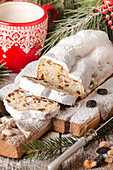 Stollen, traditional German Christmas cake on a rustic festive table