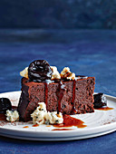 Flourless chocolate cake with prunes and blue cheese