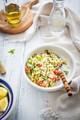 Simple lebanese salad with bulgur parsley, mint and tomatoes