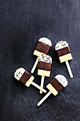 Cake pops with melted white and dark chocolate