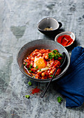Shakshuka with tomatoes and fried eggs (North Africa)