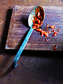 A spoon with tomato sauce