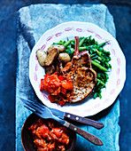 Pork chops with beans, cabbage, potatoes and tomatoes