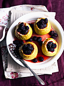 Baked apples with vanilla cream and blackberries