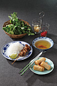 Bun cha (spring rolls, rice noodles with meat skewer and herbs, Vietnam)