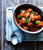 Meatballs with arrabiata sauce and basil