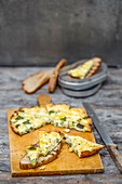 Courgette and mint frittata on grilled amaranth and rice bread