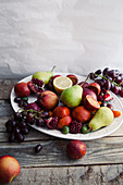 Fresh fruit platter with pomegranate, grapes and pears