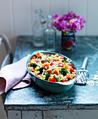 Sweet potato pasta bake with broccoli, carrots and tomatoes