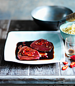 Tuna steaks in teriyaki marinade with chillies