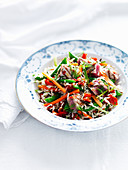 Wild rice salad with carrots, peppers and tuna