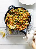 Vegetable paella with peas and carrots