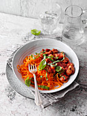 Carrot noodles with soya meat substitute