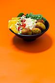 Falafel bowl with tahini and orange dressing