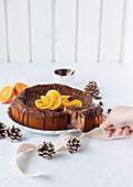 Chocolate orange cheesecake being sliced