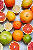 Assorted citrus fruit, whole and halved