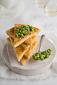 Farinata con fave e pinoli (chickpea flatbread with fava beans and pine nuts, Italy)