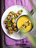 Tempeh skewers with turmeric sauce