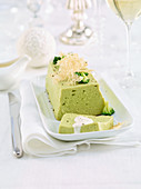 Broccoli flan with parmesan sauce and grated parmesan