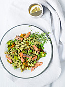 Wholemeal fusilli with peas, salmon trout and courgette flowers