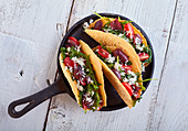 Tacos with smoked provolone cheese and vegetables