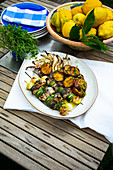 Grilled fish and vegetable kebabs