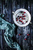 Cherries in an old colander