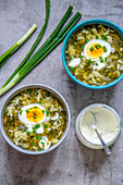 Vegetable soup with hard boiled eggs and spring onions
