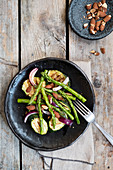 Asparagus salad with zucchini and roasted peanuts