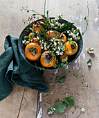 Bowl of persimmons and snowberries