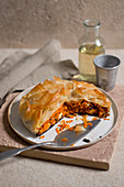 Crispy carrot pie with orange and purple carrots, feta cheese and peppermint