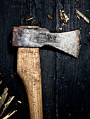 An axe on a wooden surface