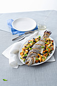 Roasted trout with olive panzanella