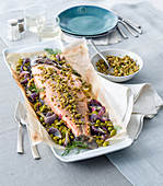 Salmon trout en papillote with fava beans, red onions, lemon and lime