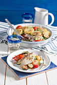 Plaice gratin with potatoes, courgettes and tomatoes