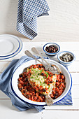Dory fish puttanesca with capers and olives