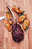 Grilled dry-aged tomahawk steaks with sweet potatoes