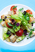 Pineapple salad with cherry tomatoes and grilled Ciabatta croutons
